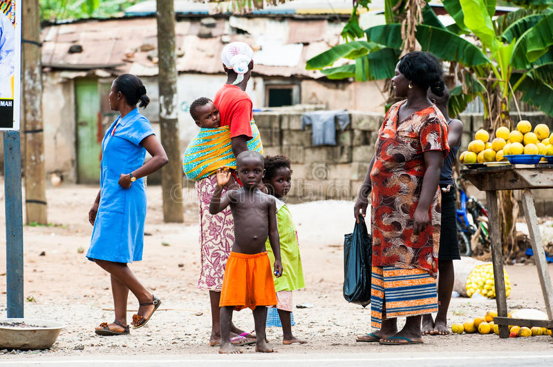 People in GHANA. ACCRA, GHANA - MARCH 2, 2012: Unidentified Ghanaian women with their children in the street in Ghana. People of Ghana suffer of poverty due to stock images