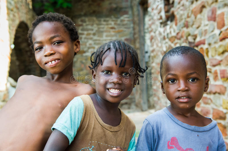 People in GHANA. GHANA - MARCH 2, 2012: Three unindentified Ghanaian children smile for the camera in Ghana, on March 2nd, 2012. People in Ghana suffer from royalty free stock photography
