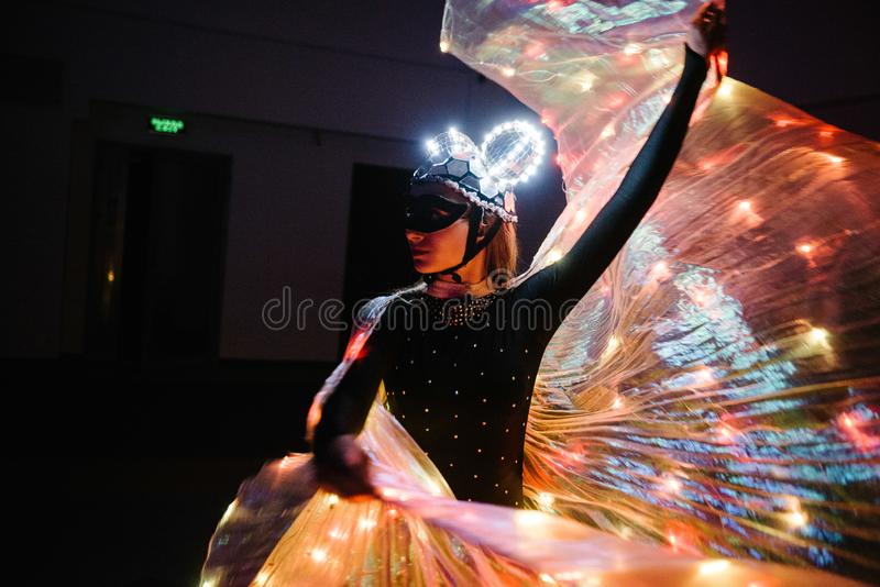 People in glowing costumes dancing in the dark. People in luminous costumes dance in the dark for a holiday, event, dancing, entertainment, dancer, light, glow royalty free stock photos