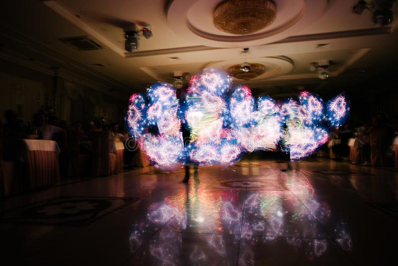 People in glowing costumes dancing in the dark. People in luminous costumes dance in the dark for a holiday, event, dancing, entertainment, dancer, light, glow stock photos