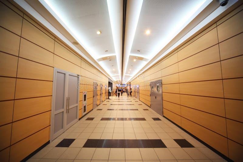 People go through corridor in airport stock photography