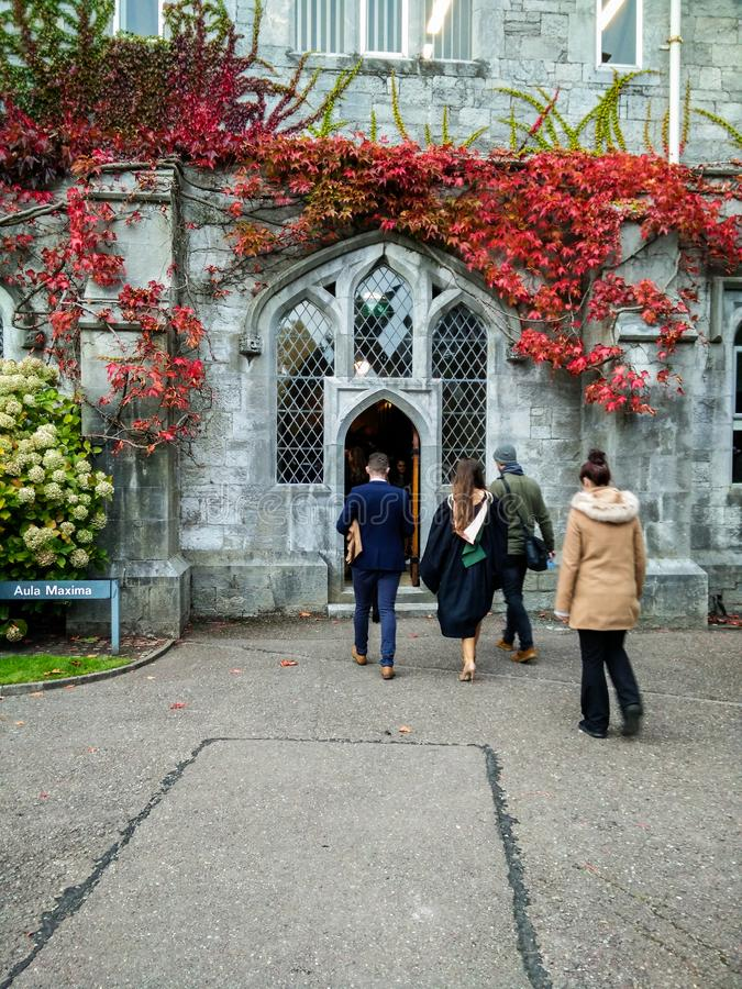 Ireland. Cork. University College of Cork. The UCC. People go to the Aula Maxima stock photos