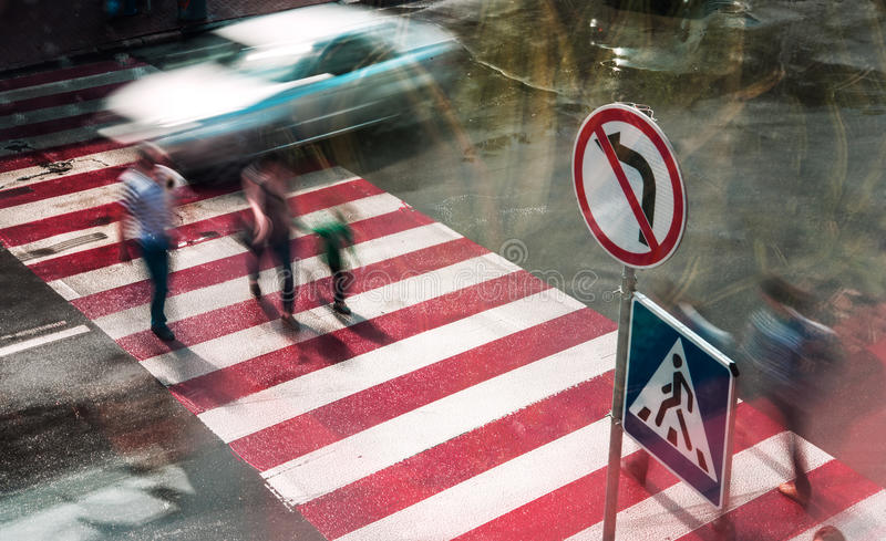 People go to the crossroads at a pedestrian crossing. Blurred motion. royalty free stock photo