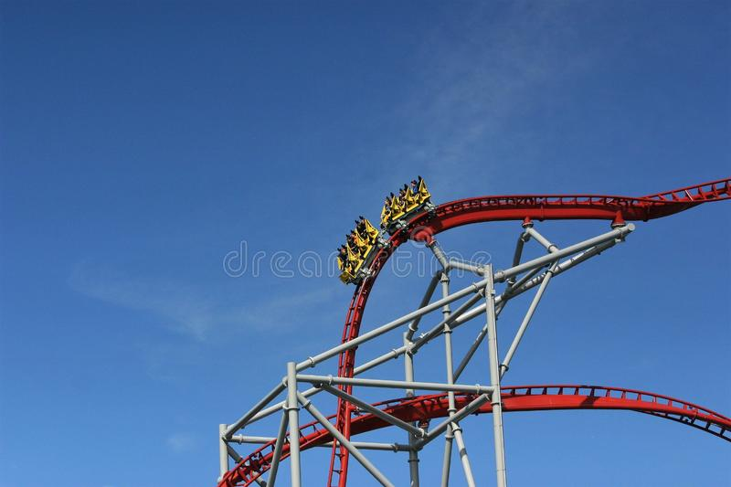 People speeding downhill on a rollercoaster royalty free stock images