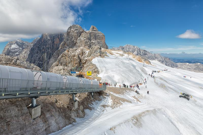 People going down at stairs to surface of Dachstein glacier stock photos