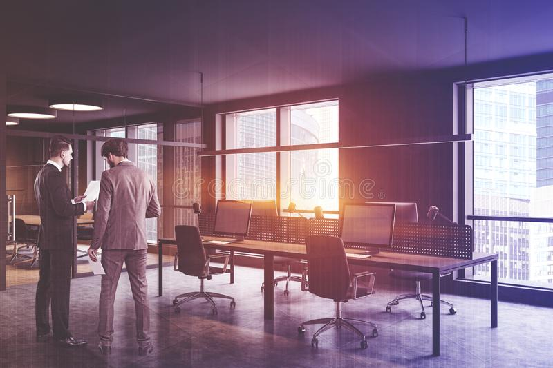 People in gray open space office corner royalty free stock image
