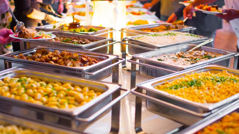 People group catering buffet food indoor in luxury restaurant. With meat colorful fruits and vegetables royalty free stock photos