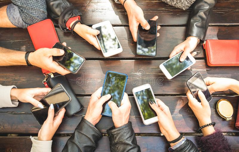People group having addicted fun together using smartphones - De stock image