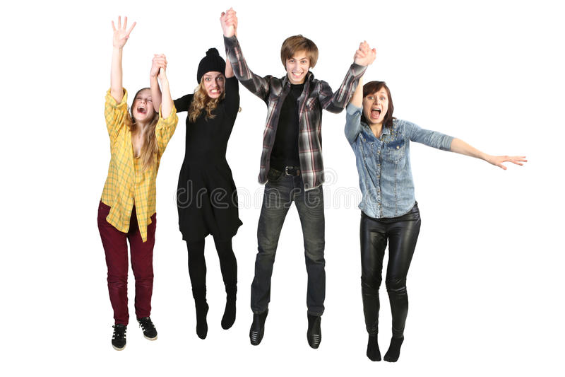 Happy people. A people group jumping for happiness and joy with the raised hands stock photography