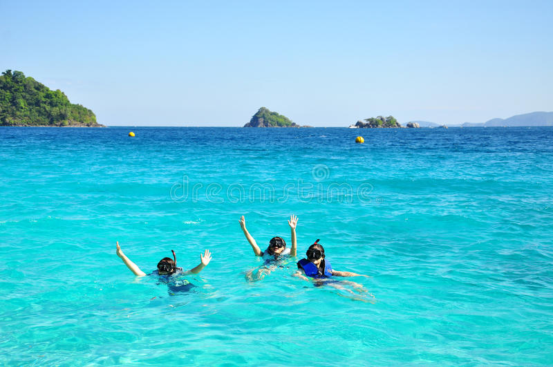 People group with snorkel on ocean. Travel summer vacation beach people group with snorkel. Kood island, Thailand stock photography