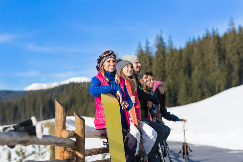 People Group With Snowboard And Ski Resort Snow Winter Mountain Cheerful Friends. Extreme Sport Vacation royalty free stock photos