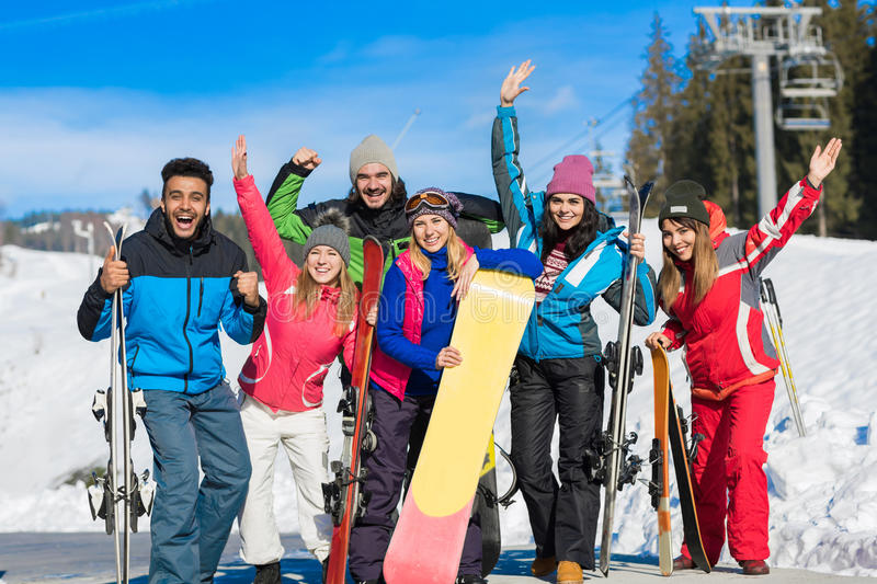 People Group With Snowboard And Ski Resort Snow Winter Mountain Cheerful Waving Hands. Having Fun stock image