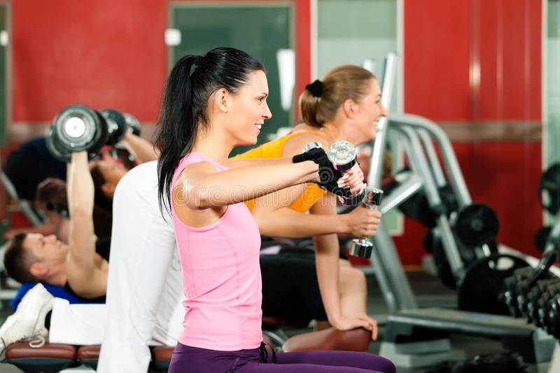 Download People In Gym Exercising With Weights Royalty Free Stock Photos - Image: 18730688