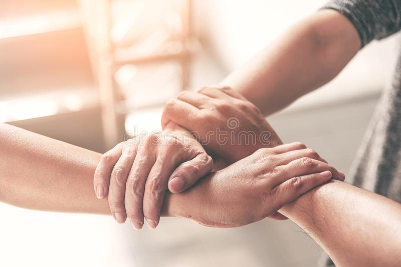 People hand assemble as a connection meeting teamwork concept. Group of people assembly hands as business or work achievement. Man royalty free stock image