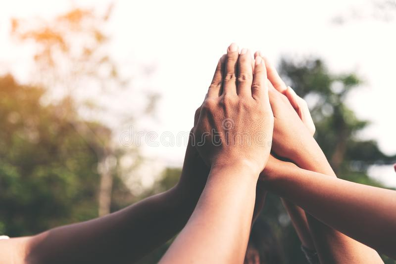 People hands assemble as a connection meeting teamwork concept. Group of people assembly hands as a business or work achievement, stock images