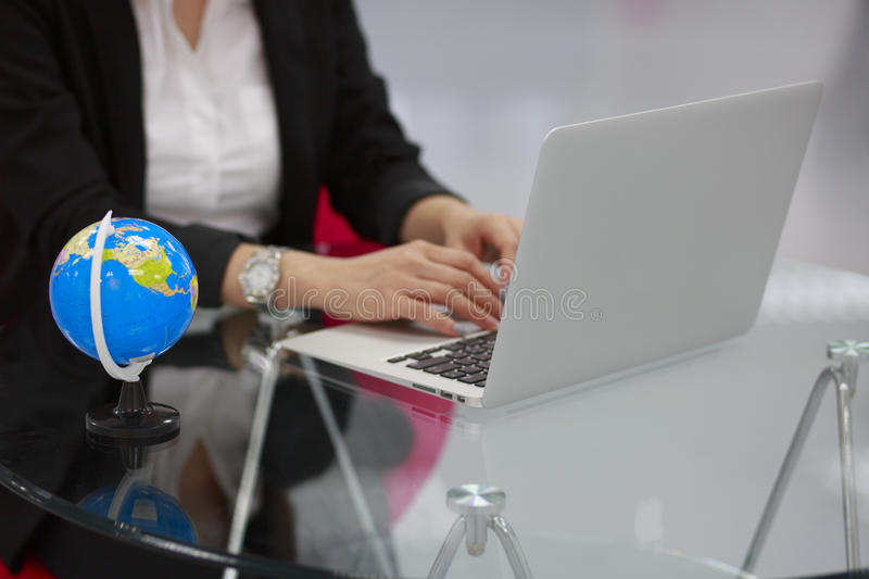 People hands typing on laptop keyboard stock image