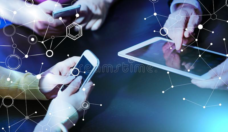 People hands using mobile phones and digital tablet; multiple exposure stock image