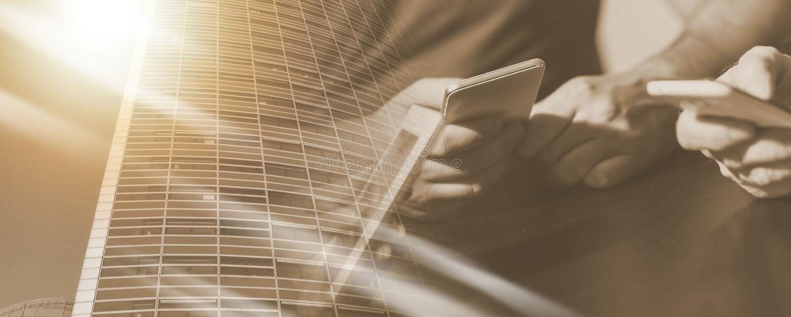 People hands using mobile phones; multiple exposure royalty free stock photography