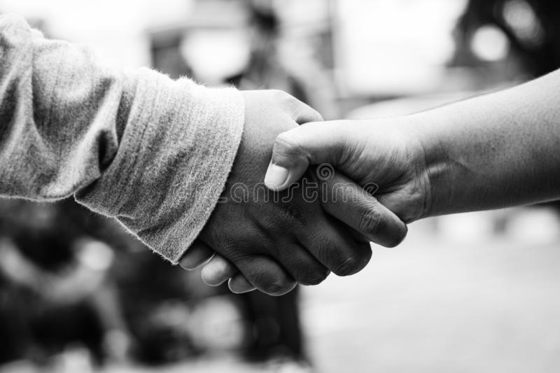 People handshaking after meeting in outdoor area , handshaking after business deal royalty free stock image