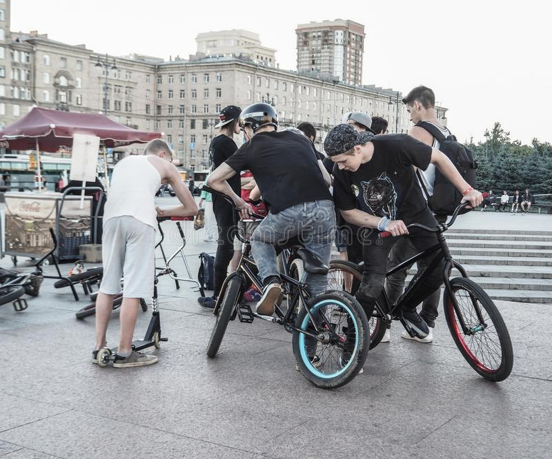 People hanging about, bikers gang hangout. Young boys hanging out at a skate place. Russia. Saint-Petersburg. Summer 2017 stock photos