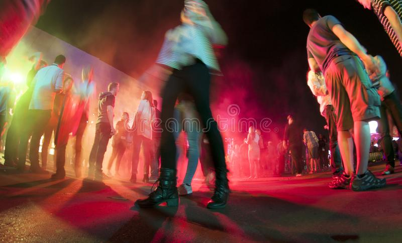 People hanging out at an outdoor party stock image