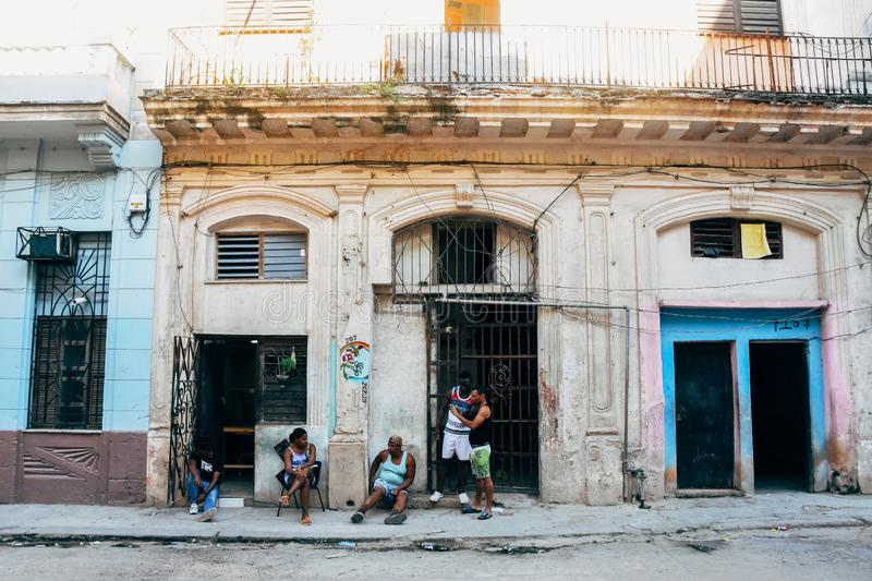 People hanging out in Havana city, Cuba. People hanging out on the street in Havana city, Cuba royalty free stock photos