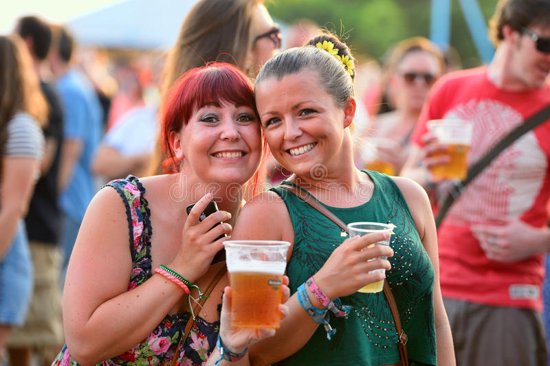 People have fun drinking beer and watching concerts at FIB Festival stock photography