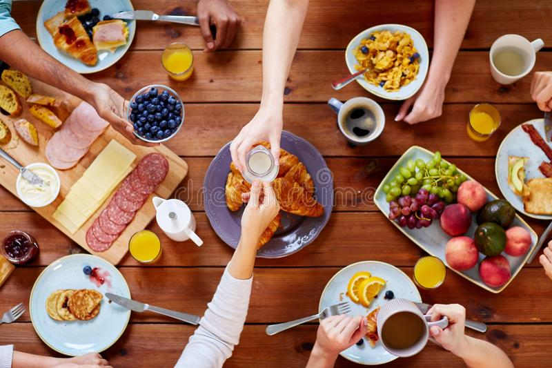 People having breakfast at table with food royalty free stock images