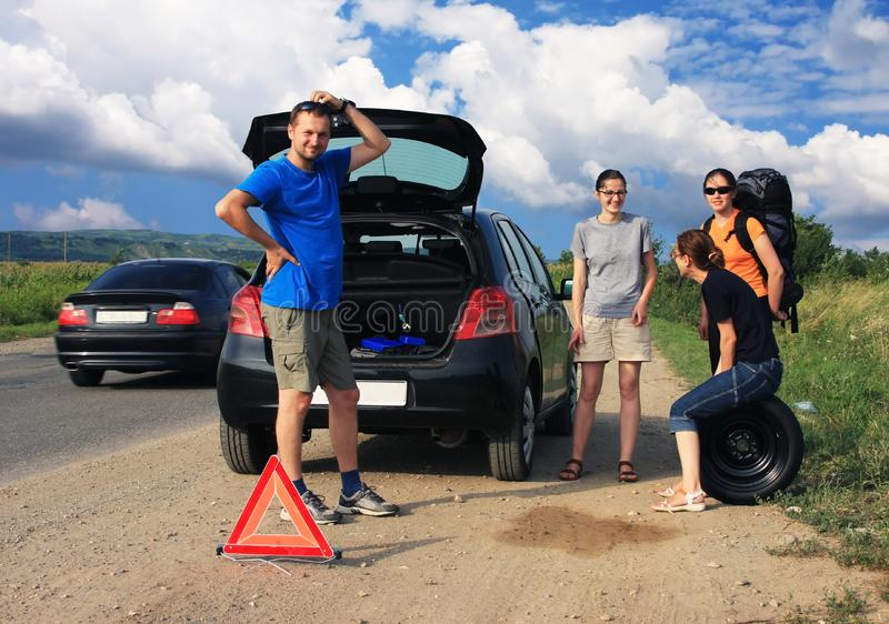 People having a flat tire stock photos