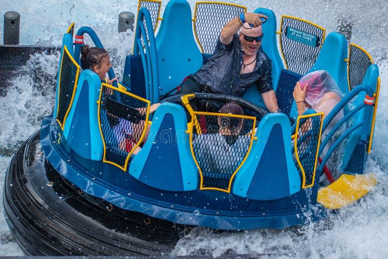 People having fun with a big splash in Infinity Falls at Seaworld 18 royalty free stock image
