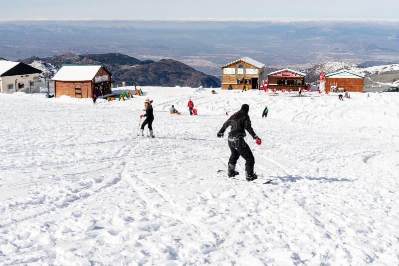 People having fun doing winter sports in Sierra Nevada. stock photography