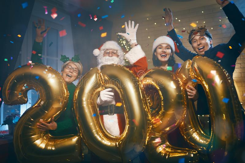 People are having fun and holding numbers 2020 royalty free stock image