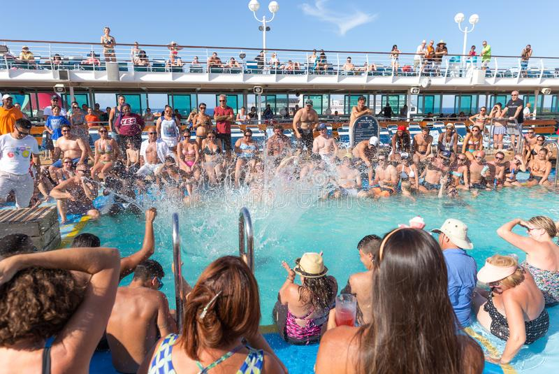 People having fun in pool on cruise ship royalty free stock image