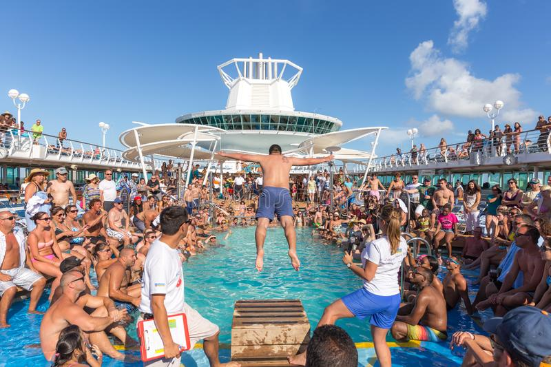 People having fun in pool on cruise ship stock images
