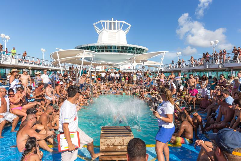 People having fun in pool on cruise ship royalty free stock photography