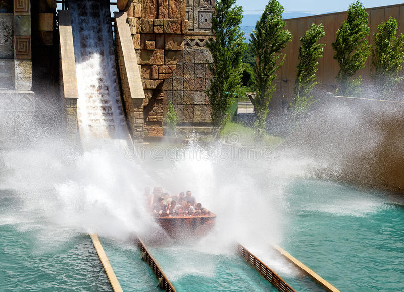 People having fun at rafting attraction royalty free stock photography