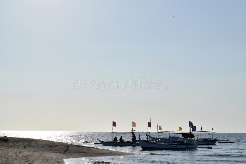 People having fun riding on tourist boat during summer. silhouettes royalty free stock photo