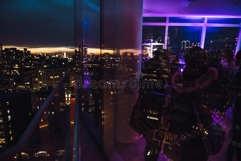 People having fun, talking, interacting on city event or presentation on the rooftop at the night royalty free stock images