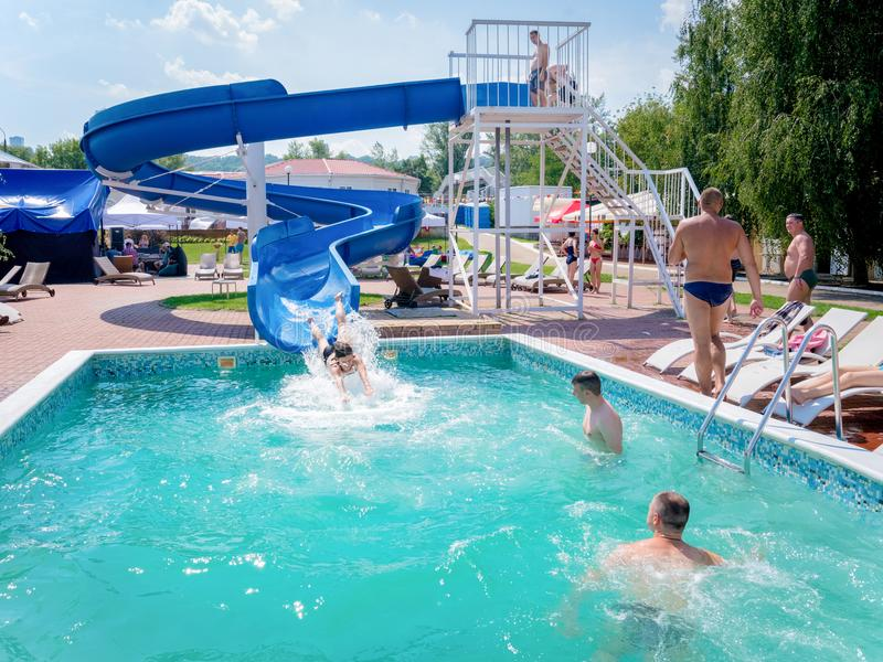 People having fun on waterslide stock photography