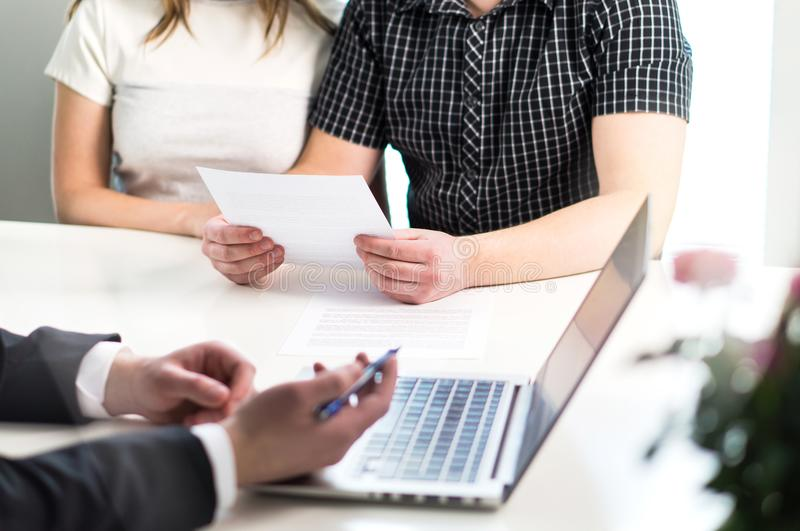 People having meeting about mortgage, bank loan, buying house. stock image