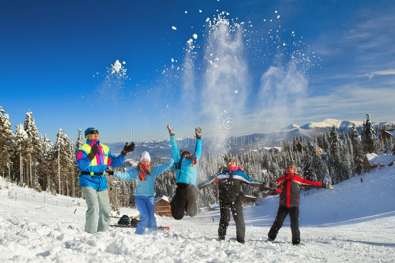 People having snowball fight stock photography