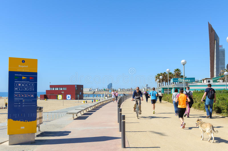 People are having sports activities at Barceloneta beach in Barcelona, Spain royalty free stock photography