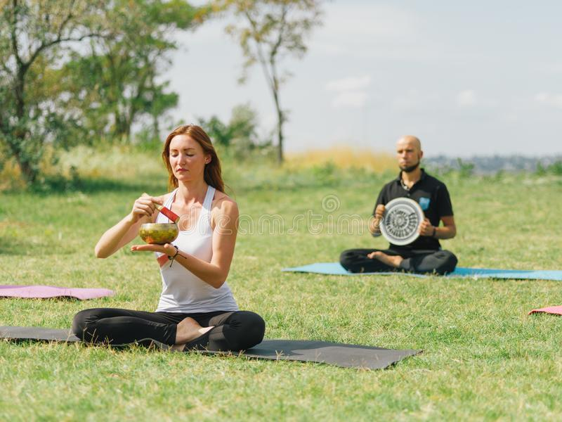 Fitness team are exercising in the park. Yoga concept. royalty free stock photography