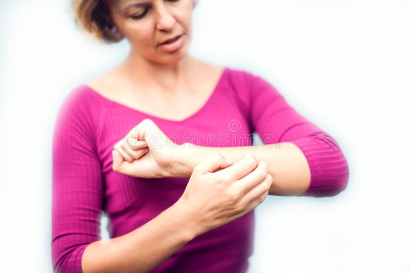 People, healthcare, dermatology, allergy and health problem concept - unhappy woman suffering from hand inch isolated royalty free stock photography