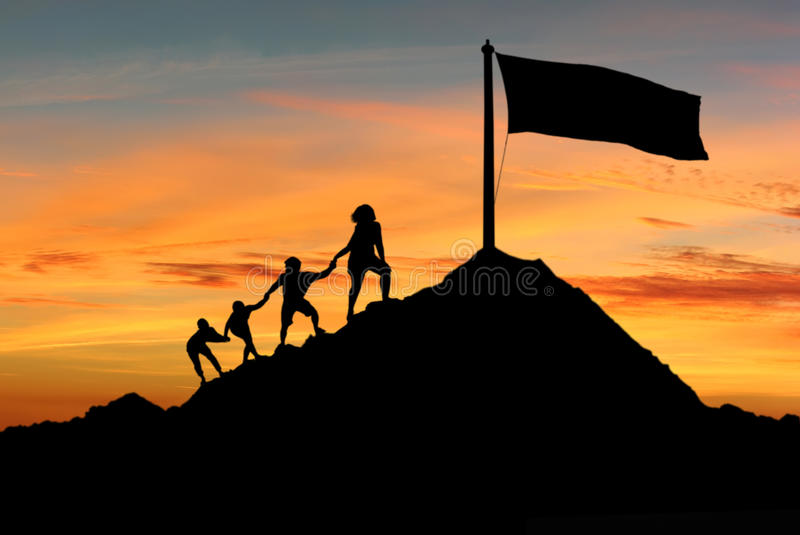People helping each other to reach top of the mounting royalty free stock image