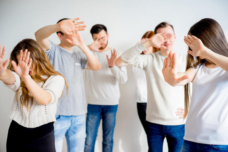 People hiding faces. Group of people hiding their faces with hands stock images