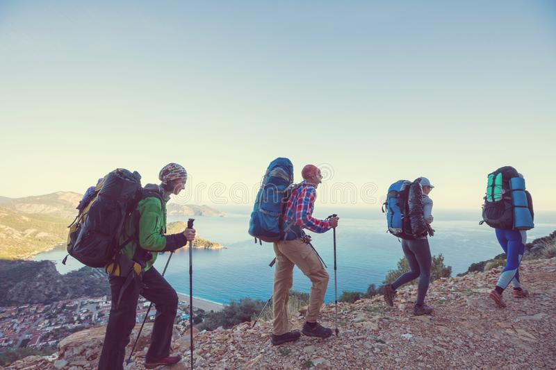 People in hike. In the mountains stock image