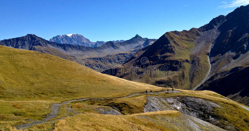 People hiking on the alps stock photography