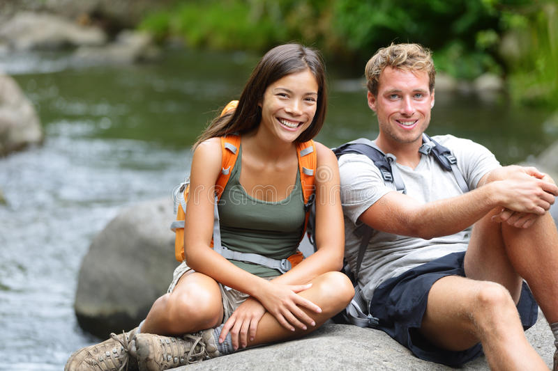People hiking - resting hikers portrait at river stock photo