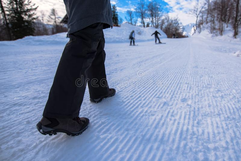 People hiking on snow path in winter time royalty free stock photos
